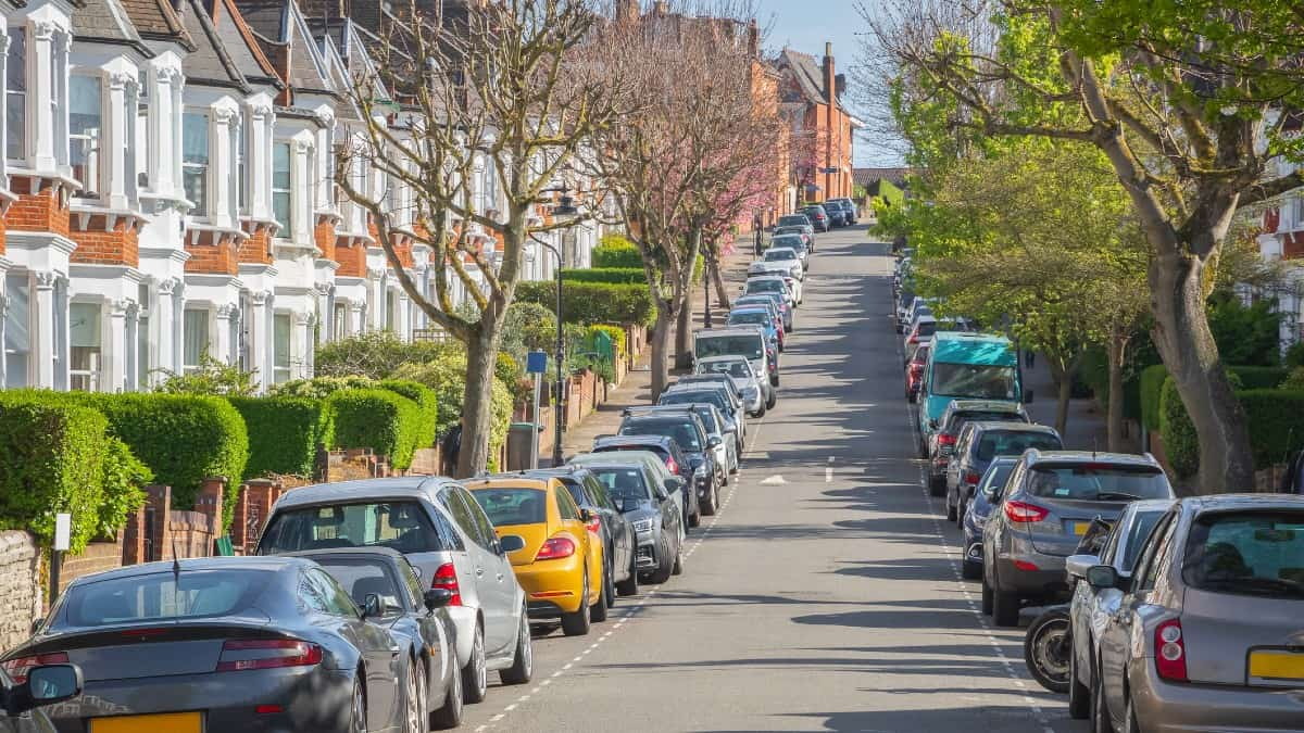 Typical street lined with terraced houses and parked cars